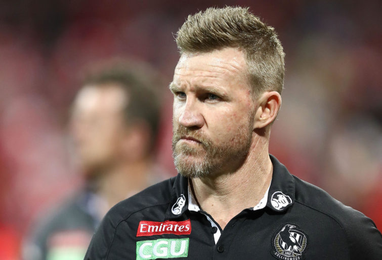 Nathan Buckley, coach of the Magpies, looks dejected