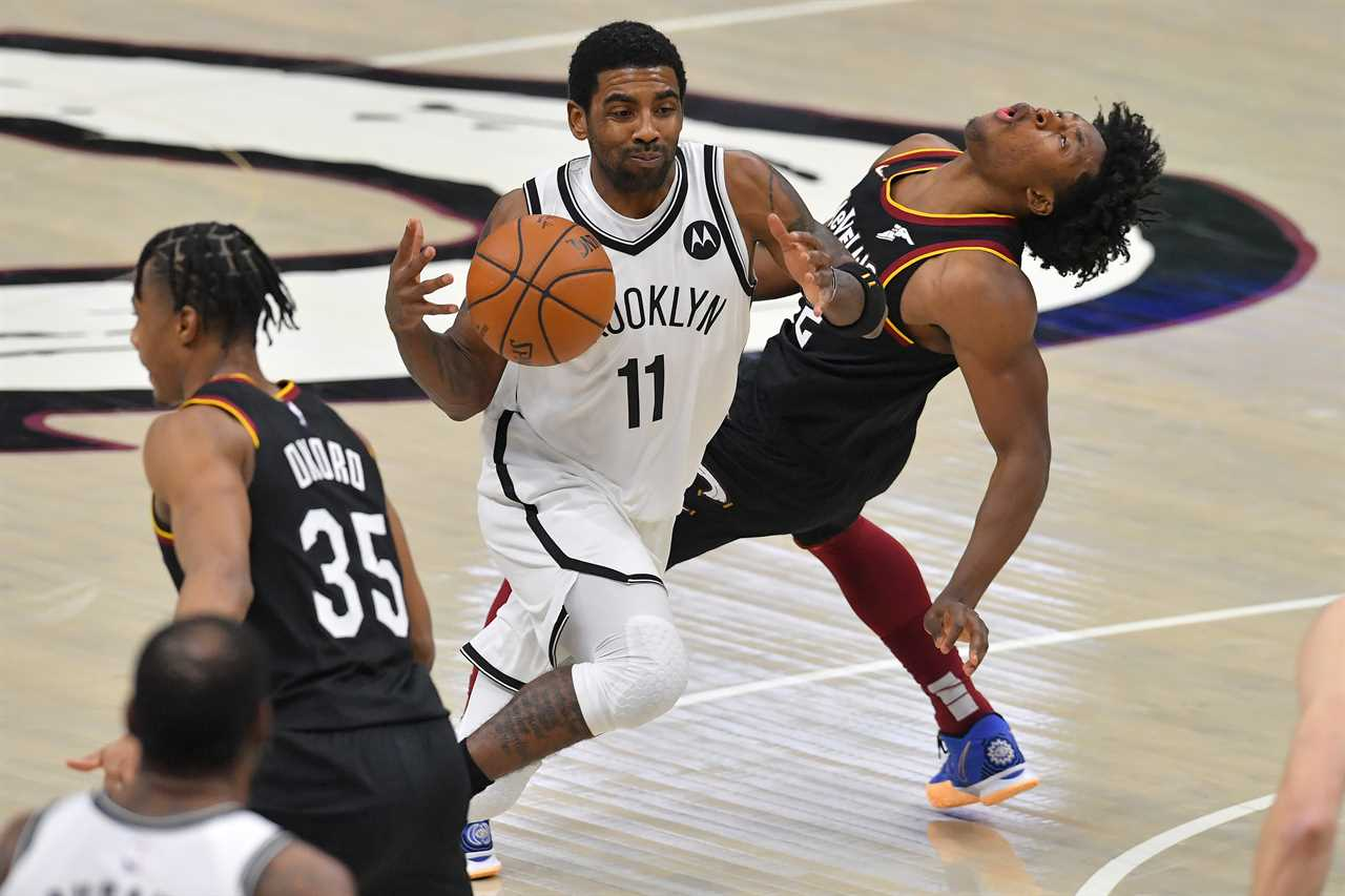 Kyrie Irving of the Brooklyn Nets runs into Collin Sexton of the Cleveland Cavaliers.