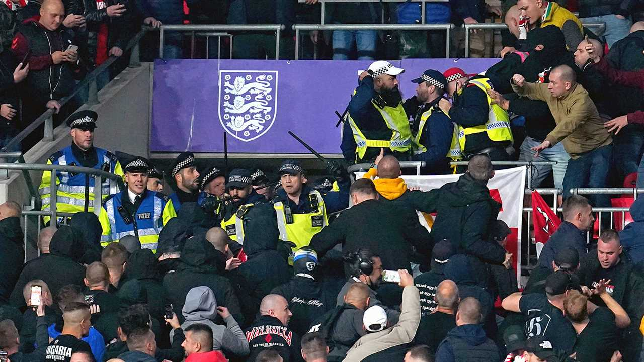 Hungary fans clash with police officers in the stands during the World Cup Qualifying soccer match between England and Hungary at Wembley Stadium.